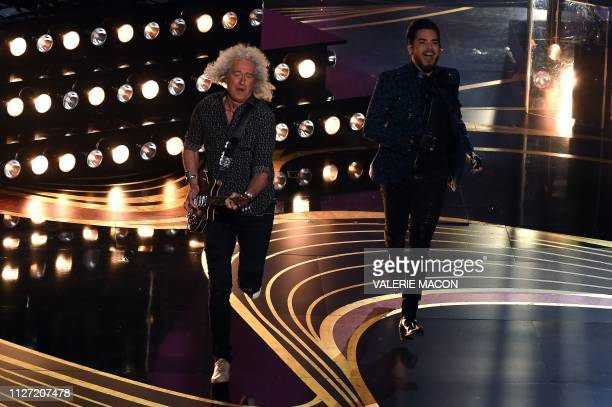 Member of British rock band Queen Brian May and US singersongwriter Adam Lambert performs during the 91st Annual Academy Awards at the Dolby Theatre...