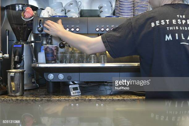 A member of Cafe Nero staff preparing a drink for a customer on Saturday 16th May 2015 in Manchester