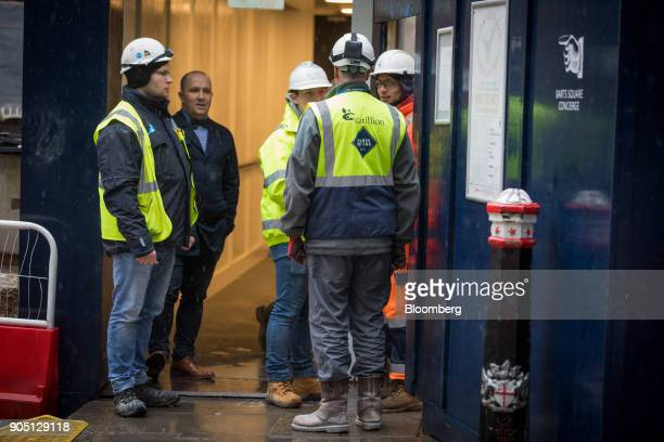 A member of Carillion's staff provides site access to subcontractors to collect their tools on the Barts Square development operated by Carillion Plc...