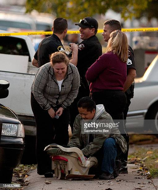 Member of child protection services takes care of an unharmed 6-month-old boy found at the scene of a triple homicide in a duplex in Rancho Cordova,...