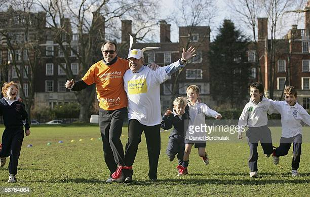 Member of Childrens Charity Childhood First Stephen Blondon and Respect Party Leader MP George Galloway head for the finish line during a three...