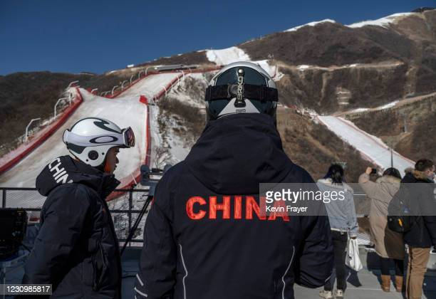 Member of China's national ski team,left, talks with a colleague next to the downhill course of the National Alpine Ski Center where alpine events...