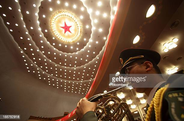 A member of China's People's Liberation Army band performs during the opening of the 18th National Congress of the Communist Party of China at the...