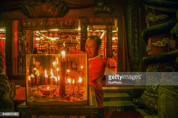 Member of chinese burn a joss sticks as he perform a specials prayer during the hungry ghost festivals in Teluk Pulai Klang Malaysia on September 12...