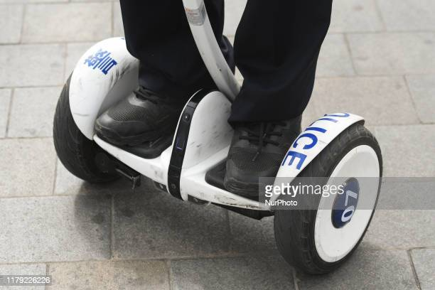Member of Chinese Police Forces seen using a segway personal transportation vehicle, seen in the center of Nanning. Saturday, October 19 in Nanning,...