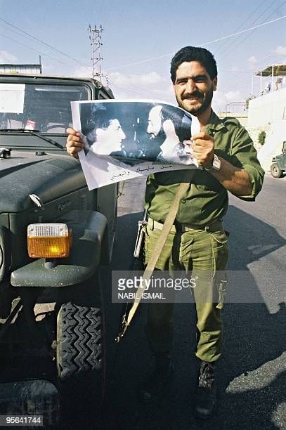 Member of Christian militia the Lebanese Forces backed by Lebanon's Christian Kataeb party displays 20 March 1985 in Helta mountain northern Lebanon...
