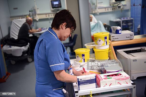 A member of clinical staff records details of blood samples in the Accident and Emergency department of the 'Royal Albert Edward Infirmary' in Wigan...