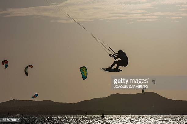 A member of Colombia's Wayuu indigenous ethnia competes in the Free Style Kitesurfing competition of the Third Kite Addict Colombia tournament in...