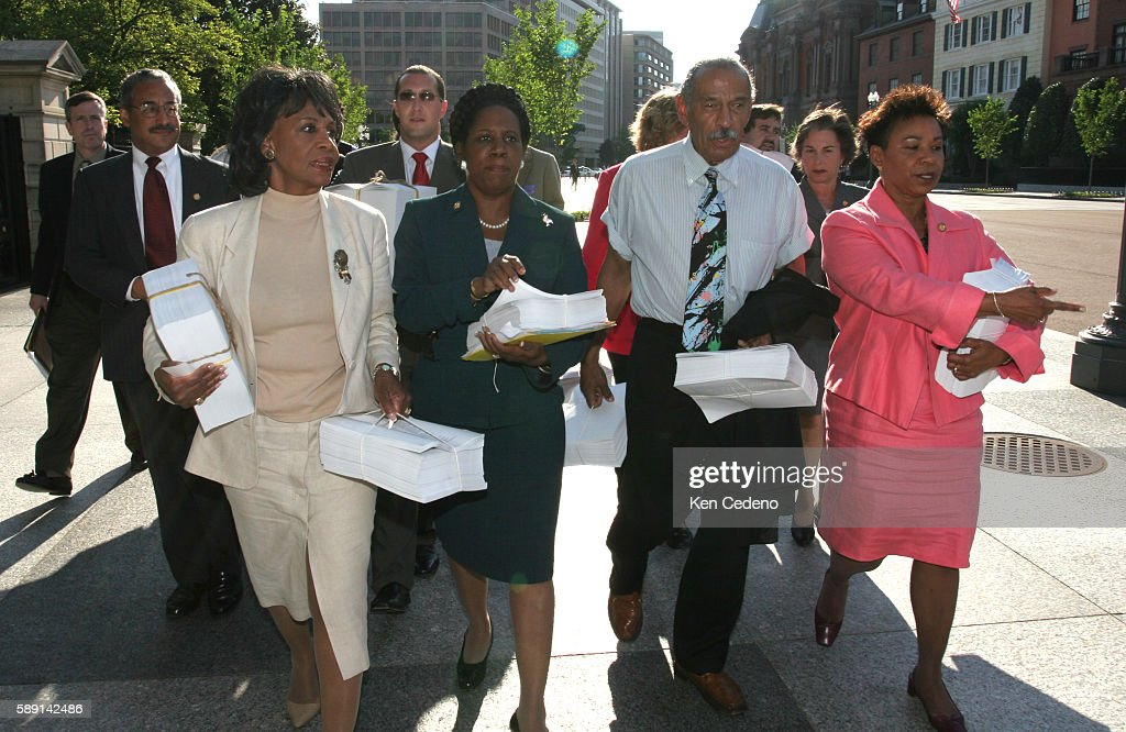 Member of Congress, front from left to right, Rep. Maxine Waters, D-Calif., Rep. Shelia Jackson Lee, D-Texas, Rep. John Conyers, D-Mich., ranking Democrat on the House Judiciary Committee, and Rep. Barbara Lee, D-Calif., accompanied by aides, walk down Pennsylvania Ave., towards the White House as they hand-deliver 540,000 petitions to President Bush at the White House in Washington DC on June 16, 2005. The petitions are signed by 105 members of Congress and more than 540,000 Americans demanding that President Bush provide a detailed response to the evidence in the 'Downing Street Memo'. The so-called 'Downing Street memo' says the Bush administration believed that war was inevitable and was determined to use intelligence about weapons of mass destruction to justify the ouster of Saddam.