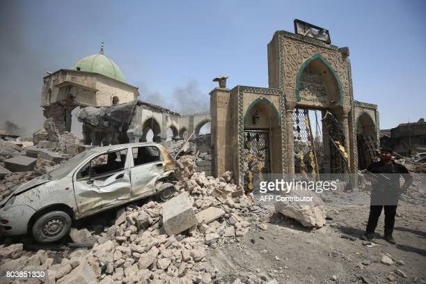 TOPSHOT A member of CounterTerrorism Service stands next to the destroyed AlNuri Mosque in the Old City of Mosul as they continue their offensive to...