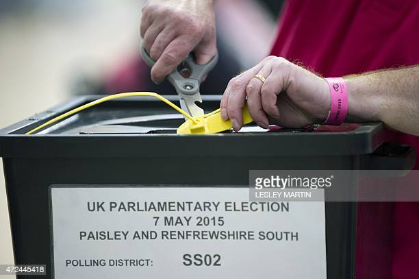 A member of counting staff opens one of the first ballot boxes to arrive at the counting centre for Paisley and Renfrewshire at the Lagoon Leisure...