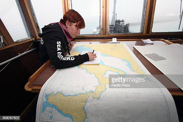 A member of crew of the Bob Barker ship with navigation chart in the control room Bob Barker ship of Sea Shepherd fleet in Venice For the first time...