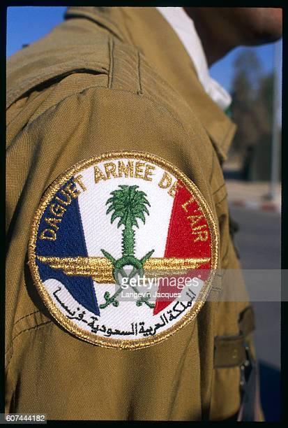 Member of Daguet Armee de L'air, the Daguet Air Force of the French military, displays a badge on his arm at Al Ahsa, a French air base near Al...