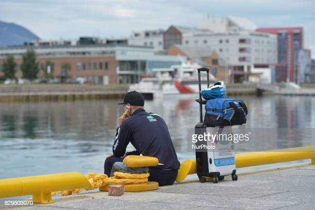 A member of Delko Marseille Provence KTM team awaiting for a boat in Harstad Harbour to be transported to the start at Andorja Island ahead of the...