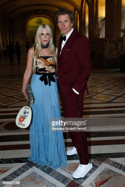 Member of 'Duran Duran' John Taylor and his wife Gela attend the 'Liaisons au Louvre IV' Evening of patronage for the benefit of the Louvre Museum at...