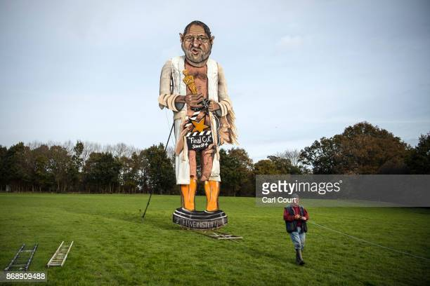 A member of Edenbridge Bonfire Society works to unveil an effigy of film producer Harvey Weinstein who is this year's 'Celebrity Guy' on November 1...