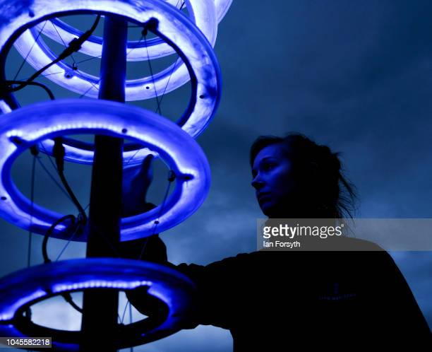 """Member of English Heritage stands next to an interactive light installation titled """"Halo"""" in the ruins of Rievaulx Abbey during a press preview..."""