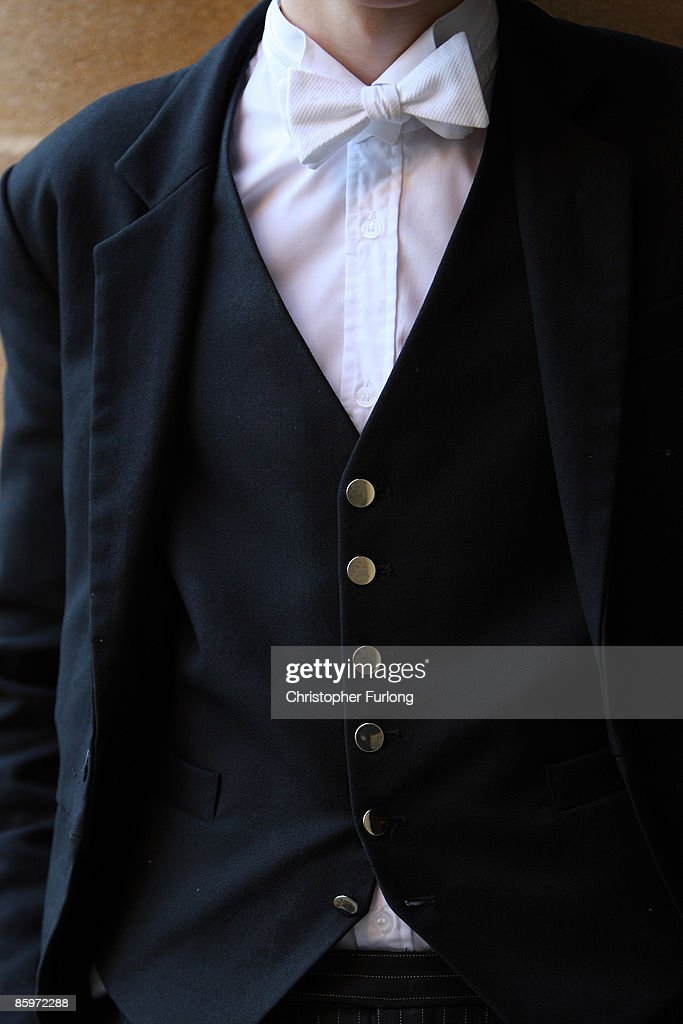 A member of Eton College's sixth form select wears his 'stick up' collar and silver buttoned waist coat which denotes that he has achieved a high level of academic success. November 15, 2007 in Eton, England. An icon amongst private schools, since its founding in 1440 by King Henry VI, Eton has educated 18 British Prime Ministers, as well as prominent authors, artists and members of royal families from around the world. The school caters for some 1300 pupils divided into 25 houses each one overseen by a housemaster chosen from the senior ranks of the staff which number around 160.