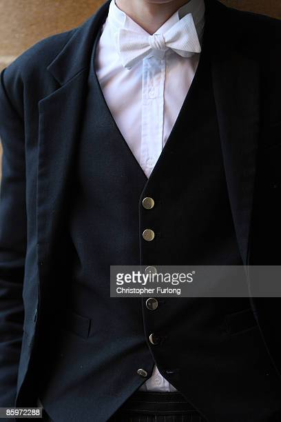 A member of Eton College's sixth form select wears his 'stick up' collar and silver buttoned waist coat which denotes that he has achieved a high...