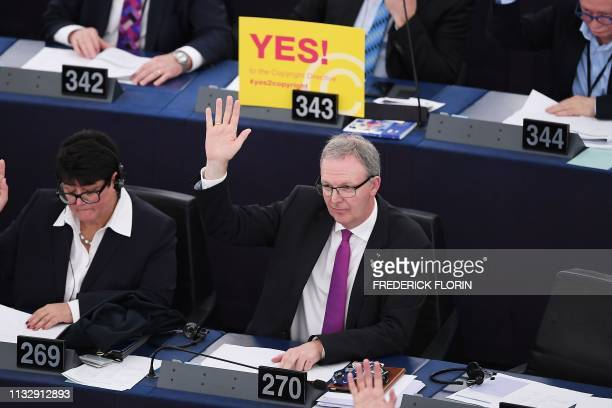 TOPSHOT Member of European Parliament Axel Voss takes part in a voting session on copyright in the Digital Single Market during a plenary session at...