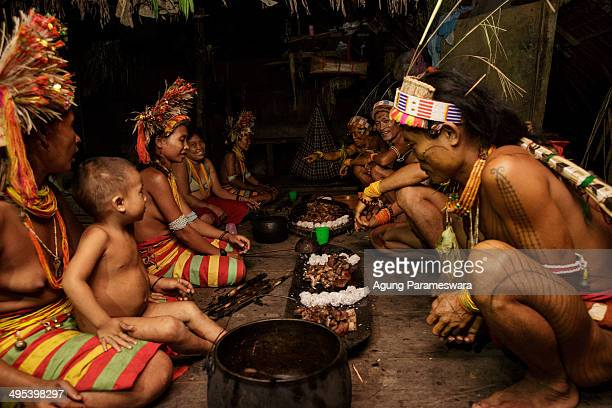 A member of family Aman Gotdai eat together to celebrate Aman Gotdai as a New Sikerei on May 26 2014 in Butui Village Siberut Island West Sumatra...
