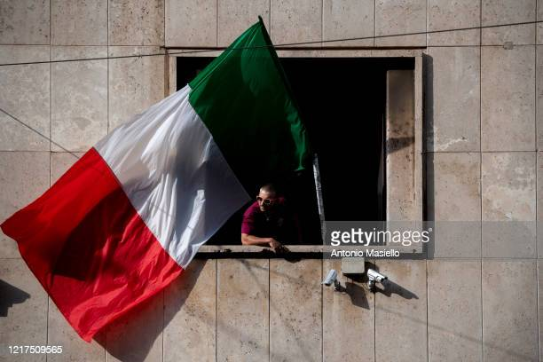 Member of far right political party Casapound waves an Italian flag during the impoundment of the Casapound headquarters, during phase three of the...
