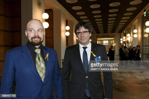 Member of Finnish Parliament Mikko Kärnä escorts Catalonia's deposed leader Carles Puigdemont as he visits the Finnish Parliament in Helsinki Finland...