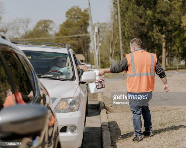 Member of First Baptist Church walks through the parking lot collecting the offering on Palm Sunday in West Memphis, Arkansas, U.S., on Sunday, April...