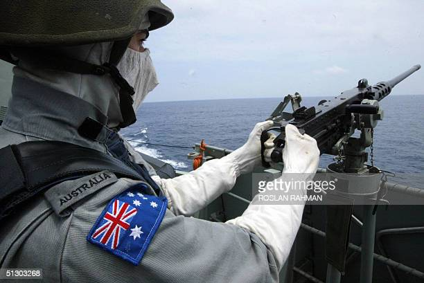A member of Five Power Defence Arrangement from Royal Australian Navy mans his machinegun onboard the HMAS ANZAC FFH150 frigate during an exercise in...