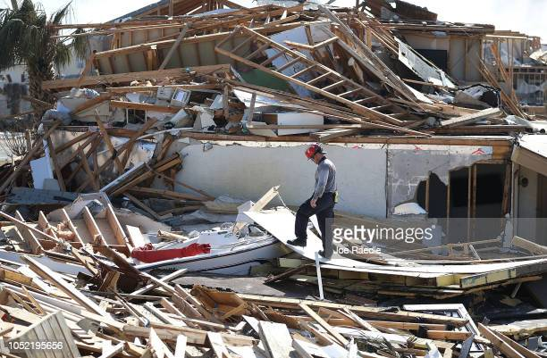 A member of Florida Task Force Two Search and Rescue continue his work of searching the area after hurricane Michael passed through on October 15...