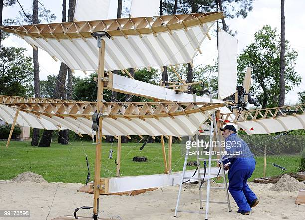 Member of 'Flyersteam' old aircraft association Marc Bulin checks the aerofoils of 'Le Canard' French first seaplane replica on May 13 2010 in...