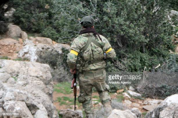 A member of Free Syrian Army backed by Turkish Army is seen after they liberated Umar Ushaghi village in the north of Syria's Afrin during an...