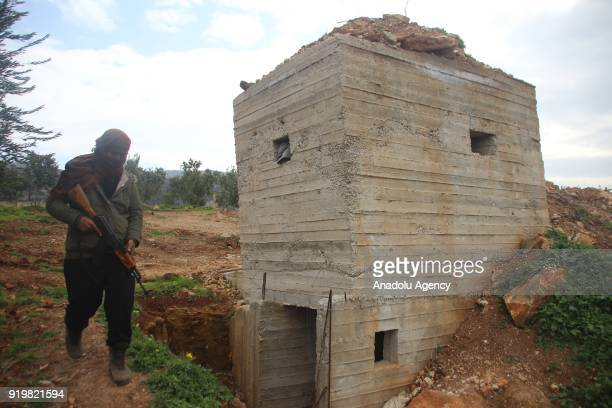 A member of Free Syrian Army patrols the Shadia village as they found new underground tunnels of PYD/PKK terrorists within the 'Operation Olive...