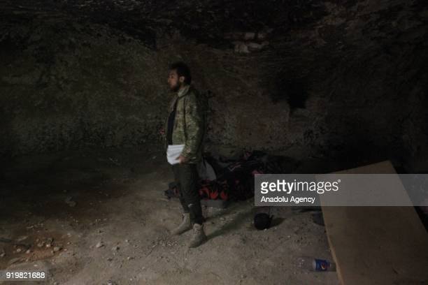 A member of Free Syrian Army searches the newly found underground tunnels of PYD/PKK terrorists within the 'Operation Olive Branch' in Shadia village...