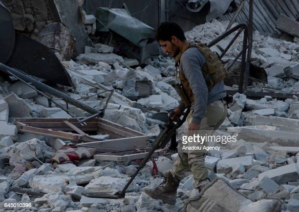 A member of Free Syrian Army uses a mine detector in the Syrian town of Al Bab after the town center has been entirely freed from Daesh terrorists as...