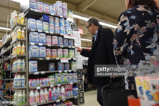 A member of French General Directorate of Competition Policy Consumer Affairs and Fraud Control checks baby milk products in a supermarket in Orleans...