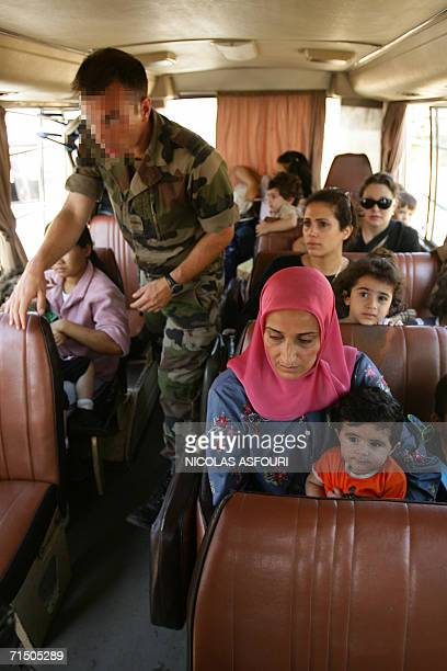 A member of French Hubert commando inspects passengers in a bus as he secures an evacuation of foreign nationals from the southern town of Nabatiyeh...