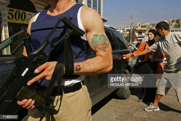 A member of French police unity GIGN secures an area in the centre of the southern Lebanese town of Nabatiyeh as the unity evacuates a family to be...