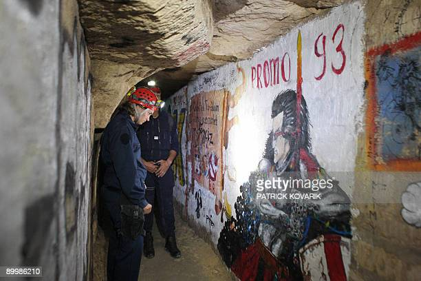 CARO A member of French special police squad 'Brigade d'intervention de la compagnie sportive' looks at a painted wall in the room called 'Galerie...