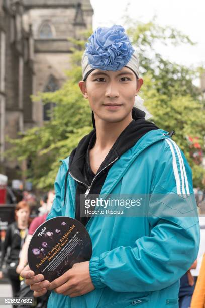 A member of Fringe festival company Korean Drum II promotes his show 'Tago' entertaining people on the Royal Mile during the third day of the annual...