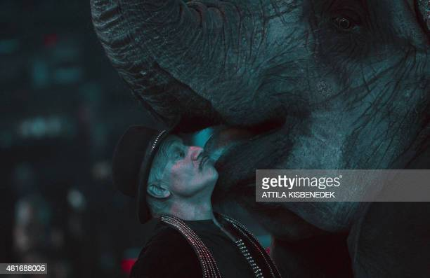 A member of German 'Caselly' family performs with an elephant during the second day of a 5day long 10th International Circus Festival in the Capital...