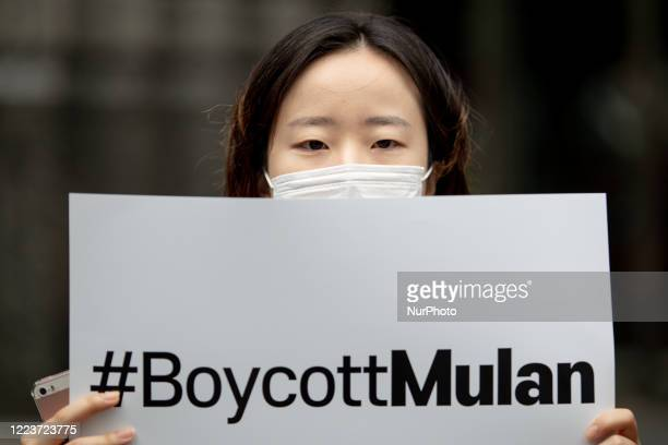 A member of Global citizenship declaration in Korea hold a placard during a protest in front of the Walt Disney Korea on July 1st 2020 in Seoul South...