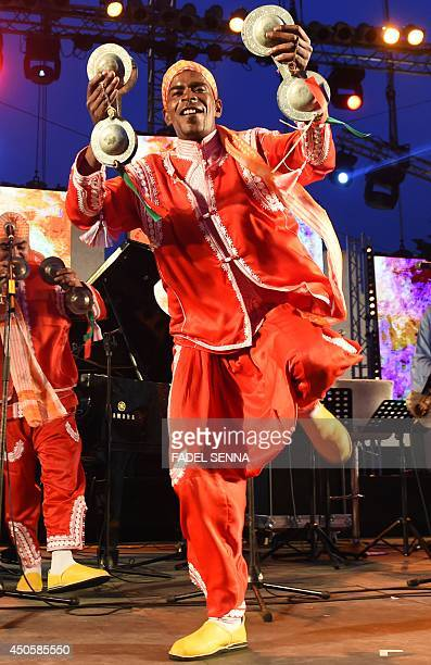 A member of Gnaoua group Maalem Reda Stitou performs in Essaouira at the Gnaoua World Music Festival on june 13 2014 The annual festival provides an...