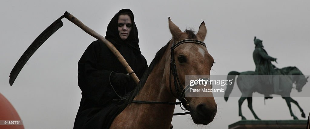 A member of Greenpeace demonstrate dressed as 'Death', one of the Four Horsemen of the Apocalypse, on December 14, 2009 in Copenhagen, Denmark. Politicians and environmentalists are meeting for the United Nations Climate Change Conference 2009 that runs until December 18. Some of the participating nation's leaders will attend the last days of the summit.