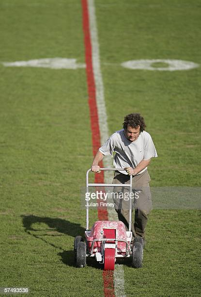 A member of ground staff makes preparations for the rugby league match which is part of the double header fixture at the Stoop today at Twickenham...