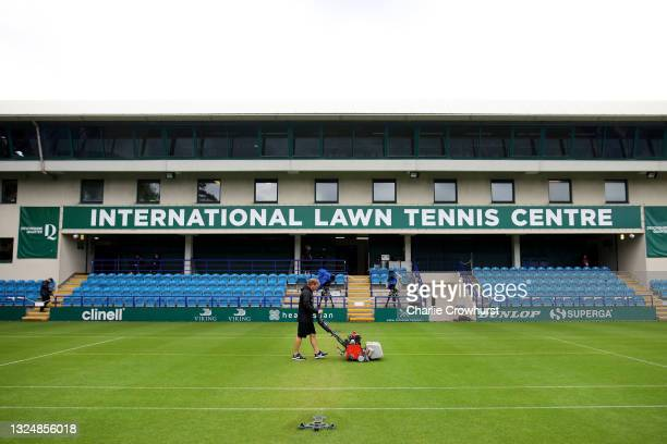Member of ground staff preps the court ahead of play as the start of play is delayed due to badweather during day 4 of the Viking International...