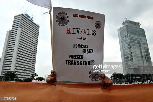A member of Hizbuth Tahrir Indonesia attends a protest against sexual deviant acts which they believe to be acts such as homosexuality bisexuality...