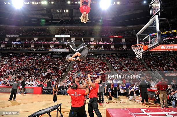 A member of Houston Rockets Anti Gravity team flips before dunking the ball during a game between the Sacramento Kings and Rockets on April 14 2013...