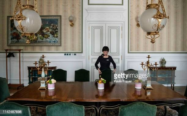 A member of Huawei's reception staff arranges the chairs in a private dining room a building used for high profile customer visits at the company's...