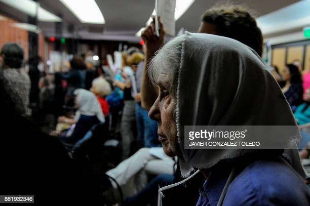 A member of human rights organization Abuelas de Plaza de Mayo is pictured during the sentencing hearing for crimes against humanity committed during...